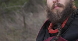 Face of the bearded knight looks at you. Camera smooth glide from garda to face stock footage