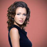 Face of  beautiful adult woman with curly hairs Stock Image