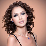 Face of beautiful adult woman with curly hairs stock images