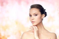 Face of beautiful asian woman with golden ring Stock Photos