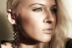 Face of beautiful blond woman in daylight. shade from the sun Royalty Free Stock Photography