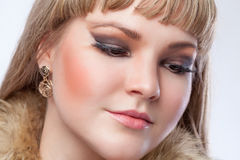 Face of a beautiful blonde girl close-up. Sad girl with downcast eyes. Beauty stock image