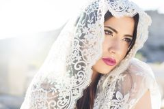 Face of a beautiful bride hidden veil Royalty Free Stock Image