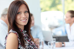 Face of beautiful business woman. Face of beautiful woman on the background of business people Stock Image