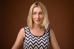 Face of beautiful businesswoman with short blond hair royalty free stock images