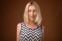 Face of beautiful businesswoman with short blond hair royalty free stock photo