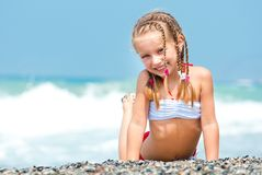 Face of the beautiful girl on a beach Stock Photo