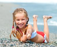 Face of the beautiful girl on a beach Stock Image