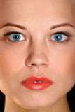 The face of the beautiful girl with blue eyes Stock Photos