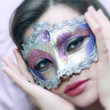 Face of a beautiful girl in a brilliant festive ma. Portrait of beautiful girl in shiny festive mask Royalty Free Stock Image