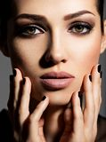 Face of a beautiful girl with fashion makeup and black nails royalty free stock photos