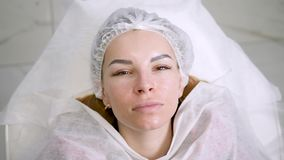 Face beautiful girl in a medical cap lying back on the couch. At the doctor stock video