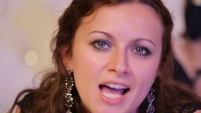 The face of a beautiful girl who sings. stock footage
