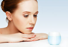 Face of beautiful healthy woman with jar of cream Stock Images