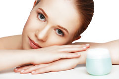 Face of beautiful healthy woman with jar of cream Royalty Free Stock Image