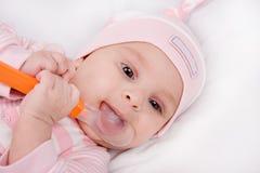 Face of a beautiful newborn girl Royalty Free Stock Photo