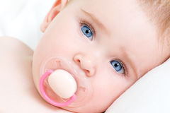 Face of a beautiful newborn girl with blue face Stock Photo