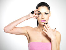 Face of the beautiful woman with black nails and pink lips Royalty Free Stock Photo