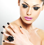 Face of the beautiful woman with black nails and pink lips. Face of the  beautiful sexy  woman with black nails and pink lips. Sexy girl with fashion makeup Royalty Free Stock Images