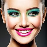 Face of a beautiful smiling girl with fashion make-up stock image