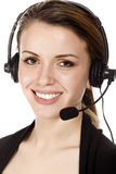 Face of beautiful smiling happy woman in headset Royalty Free Stock Photo