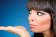 Face of a beautiful woman. Closeup of a beautiful woman looking at something on her palm, copy space available Stock Photography