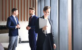 Face of beautiful woman on the background of business people. Stock Image