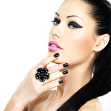 Face of the beautiful woman with black nails and pink lips Royalty Free Stock Photos