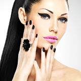 Face of the beautiful woman with black nails and pink lips Stock Images
