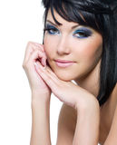 Face of a beautiful woman with blue make-up stock photo
