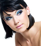 Face of a beautiful woman with blue make-up Royalty Free Stock Images