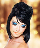 Face of a beautiful woman with blue makeup Royalty Free Stock Photos