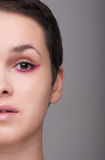 Face of a beautiful woman in closeup royalty free stock photography