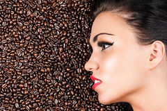 Face of a beautiful woman in coffee beans Royalty Free Stock Photo