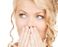 Face of beautiful woman covering her mouth Stock Photos