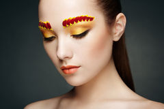 Face of beautiful woman decorated with flowers Royalty Free Stock Photos