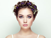 Face of beautiful woman decorated with flowers Stock Image