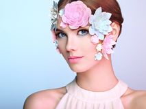 Face of beautiful woman decorated with flowers Stock Photo