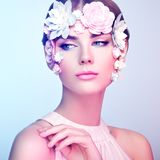 Face of beautiful woman decorated with flowers Royalty Free Stock Images