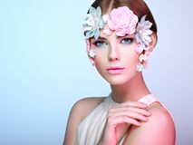 Face of beautiful woman decorated with flowers Royalty Free Stock Photo