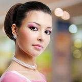 Face of beautiful woman with fashion hairstyle and glamour makeup. Over creative soft bokeh background royalty free stock image