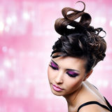 Face of beautiful woman with fashion hairstyle and glamour makeu Stock Image