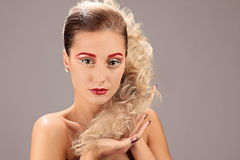 Face of beautiful woman with fashion hairstyle and glamour makeup Royalty Free Stock Images