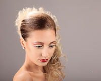 Face of beautiful woman with fashion hairstyle and glamour makeup Stock Photo