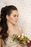 Face of beautiful woman with fashion hairstyle with roses in hands Royalty Free Stock Photo