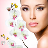 Face of beautiful woman with a  flower Stock Images