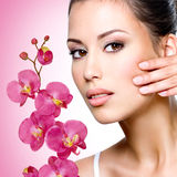 Face of beautiful woman with a  flower Royalty Free Stock Image
