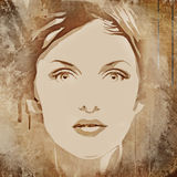 face of a beautiful woman on a grunge background Royalty Free Stock Photos