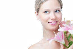 Face of a beautiful woman with lily Stock Images