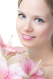 Face of a beautiful woman with lily Royalty Free Stock Image